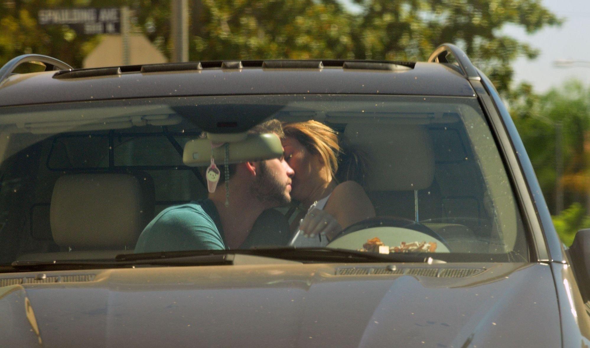 miley cyrus gyrating on car