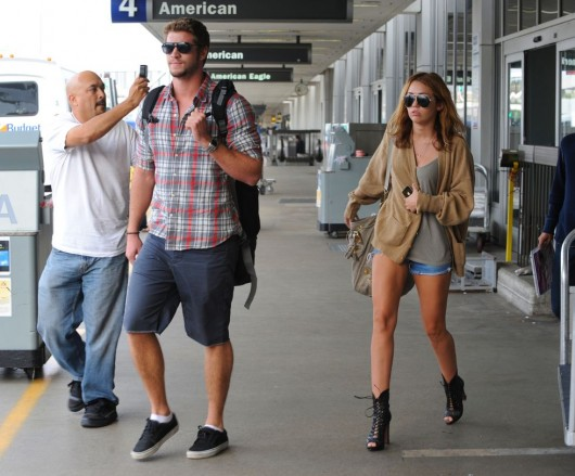 Miley Cyrus Leggy candids at LAX Airport in shorts – Sep 21