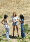 Miley Cyrus Shows legs In denim shorts on Photoshoot in Malibu