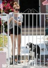 Miley Cyrus - With Her Dog-11