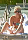 Miley Cyrus - Wearing a Bikini at a Pool in Palm Desert -11