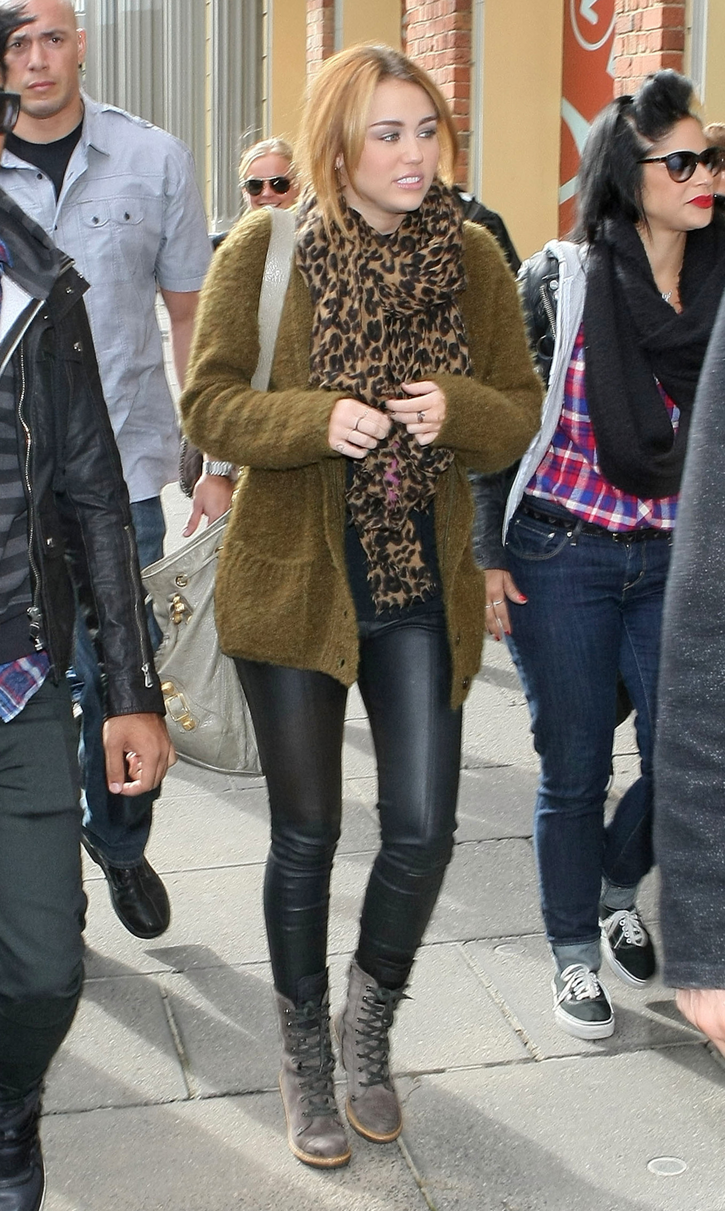 http://www.gotceleb.com/wp-content/uploads/celebrities/miley-cyrus/wearing-leather-pants-in-melbourne-june-23-201/Miley%20Cyrus%20Wearing%20Leather%20Pants%20in%20Melbourne-06.jpg