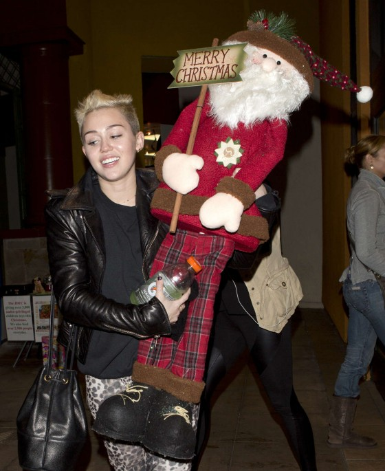 Miley Cyrus - with santa at Xmas shopping candids in Studio City