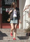 Milla Jovovich in Short Skirt at a Veterinary Clinic -04