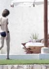 milla-jovovich-bikini-candids-in-mexico-11