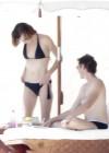 milla-jovovich-bikini-candids-in-mexico-13