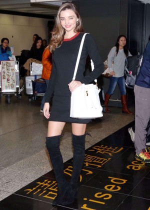 Miranda Kerr in Black Mini Dress at Hong Kong International Airport