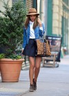 Miranda Kerr - Wearing short skirt leaving a building in NYC