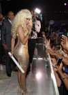 Nicki Minaj in gold tight dress performs in Las Vegas-10