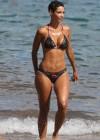 Nicole Murphy In a bikini paddleboarding at the beach -10