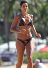 Nicole Murphy In a bikini paddleboarding at the beach -11