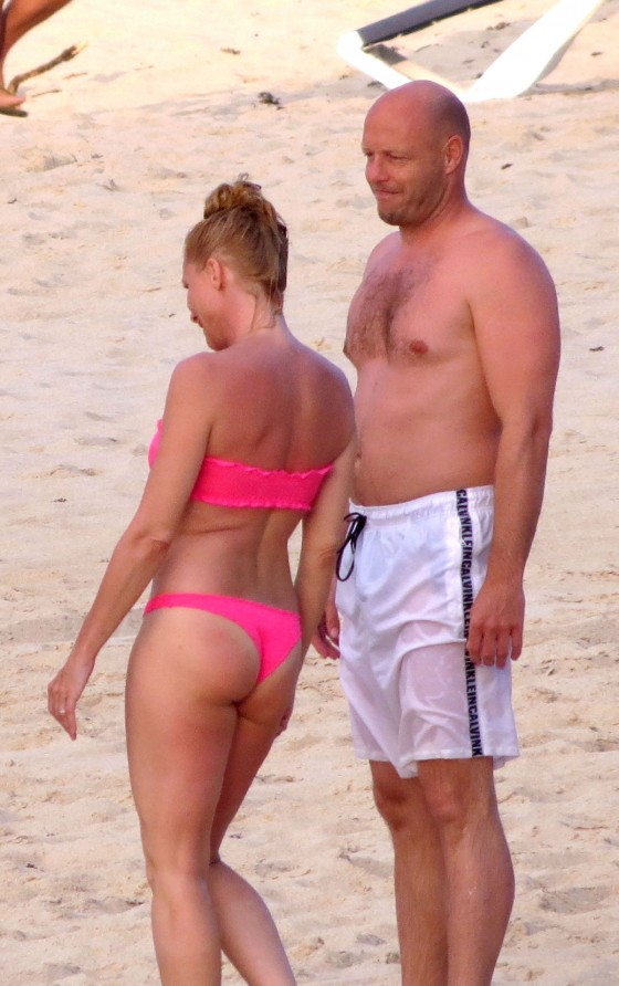 Nicolette Sheridan wear pink thong bikini at the Beach in St. Barts