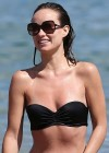 Olivia Wilde - Paddleboarding in a Black Bikini in Hawaii -01