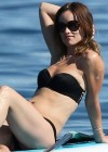 Olivia Wilde - Paddleboarding in a Black Bikini in Hawaii -09