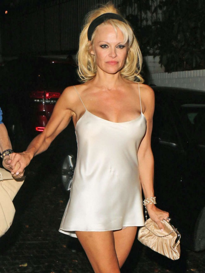 Pamela Anderson in White Mini Dress at the Chateau Marmont in West Hollywood