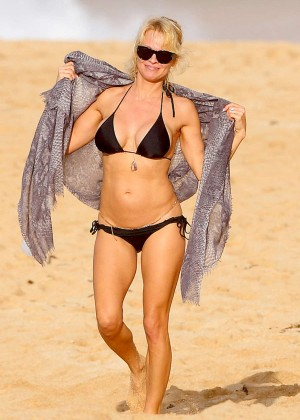 Pamela Anderson in Black Bikini on the beach in Hawaii