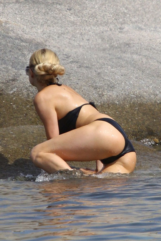 Paris Hilton wearing a swimsuit at a beach in France