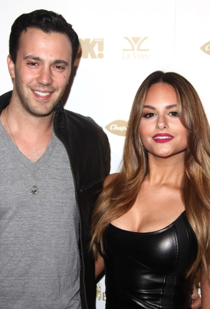 American Idol alum Pia Toscano flashes her diamond ring as it's confirmed she is engaged to boyfriend Jimmy R.O. Smith
