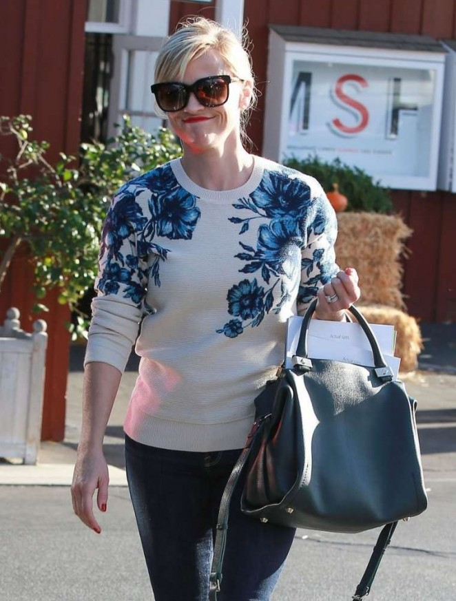 Reese Witherspoon in jeans and Floral Sweater at the Brentwood Country Mart