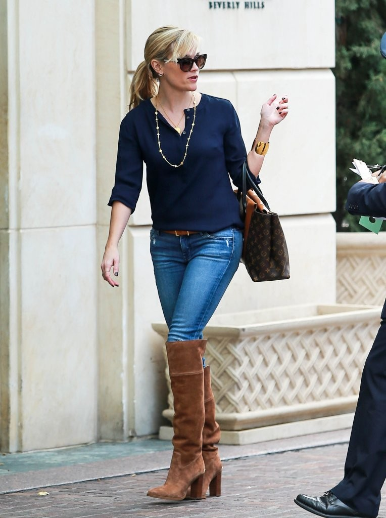 reese witherspoon in jeans and boots at the peninsula