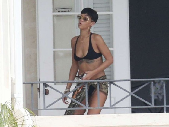 Rihanna - wearing a black bikini in Barbados