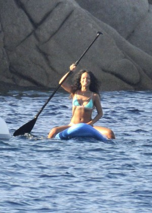 Rihanna paddleboarding in a bikini on vacation in Italy