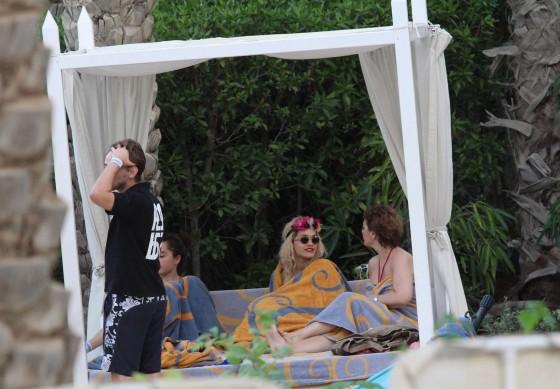 Rita Ora In White Swimsuit In a Swimming Pool in Dubai
