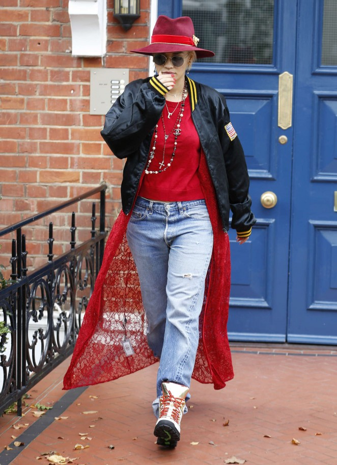 Rita Ora in Jeans Leaving her house and arriving at Heathrow airport in London