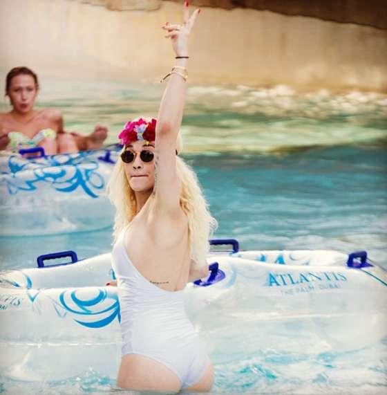 Rita Ora - Wearing a white swimsuit in twitpics
