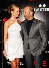 "Rosie Huntington-Whiteley in a white dress with Statham at ""Safe"" premiere in NYC"