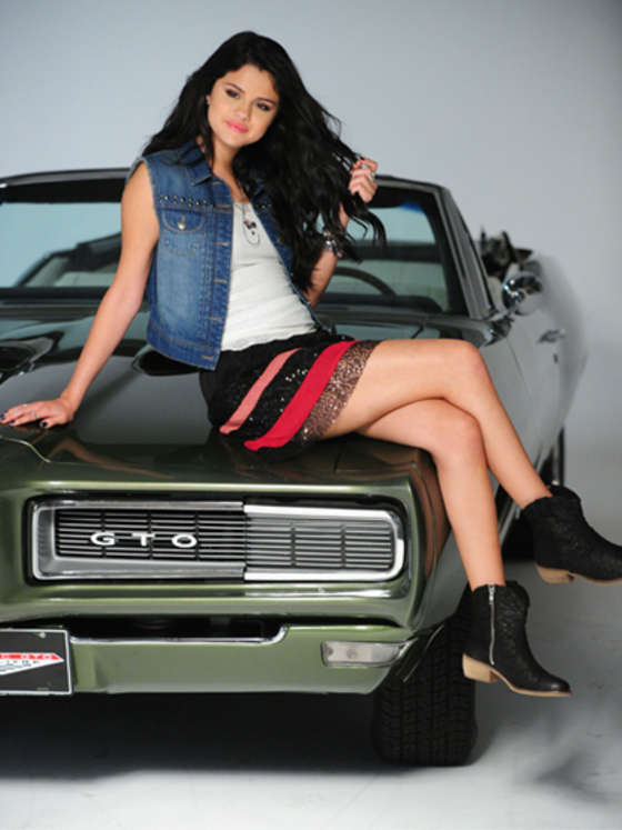 Selena Gomez Showing her legs in a mini skirt for 2012 Dream Out Loud Fall Photoshoot