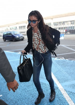 Selena Gomez in Tight Jeans at Charles De Gaulle Airport in Paris