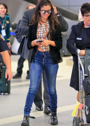 Selena Gomez in Tight Jeans at LAX airport in LA