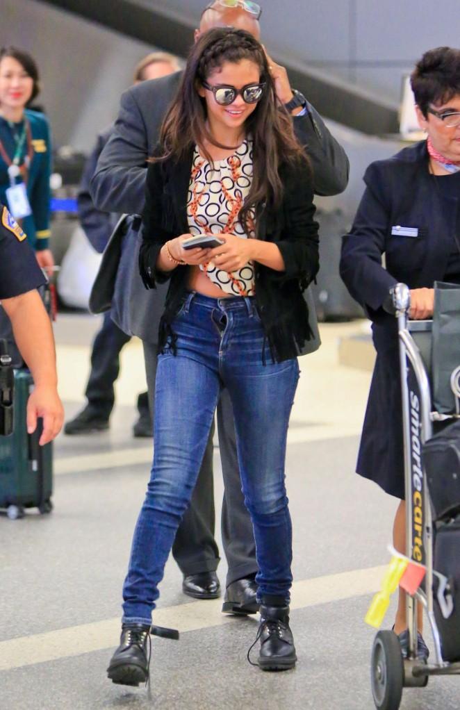 Selena Gomez in Tight Jeans at LAX airport in LA