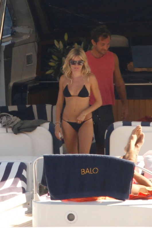 sienna-miller-in-black-bikini-in-ibiza-11
