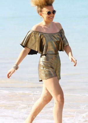 Tallia Storm in Gold Jumpsuit on the Beach in Barbados