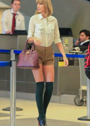 Taylor Swift in Shorts and Green Socks Arriving at LAX Airport in LA