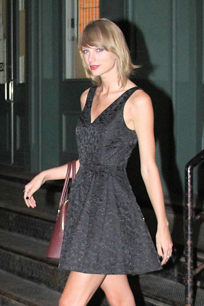 Taylor Swift in Black Mini Dress Leaving her Apartment in NYC