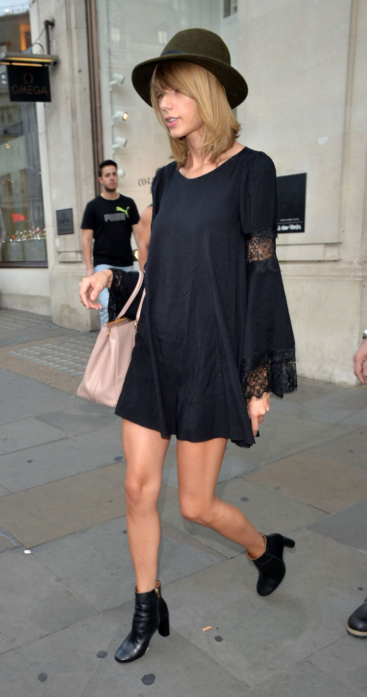 Taylor Swift in a black mini dress out in London