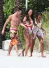 Tulisa Contostavlos in floral Swimsuit on the beach in Miami-06