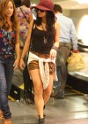 vanessa-hudgens-in-shorts-heading-to-a-movie-theater-in-hollywood-07
