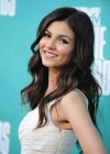 Victoria Justice Looking cute in yellow skirt at MTV Movie Awards in Universal Studios