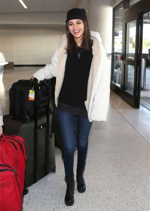 Victoria Justice in Jeans at LAX Airport in Los Angeles