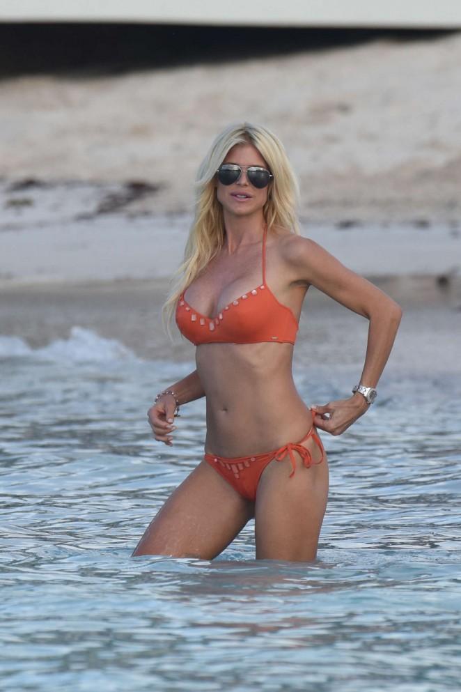 Victoria Silvstedt in Orange Bikini on the Beach in St. Barths
