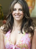 elizabeth-hurley-her-cleavage-promoting-her-swimwear-collection-in-barcelona-5410-02