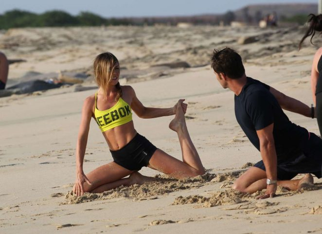 Abbey Clancy in Shorts Doing Yoga on the beach in Cape Verde