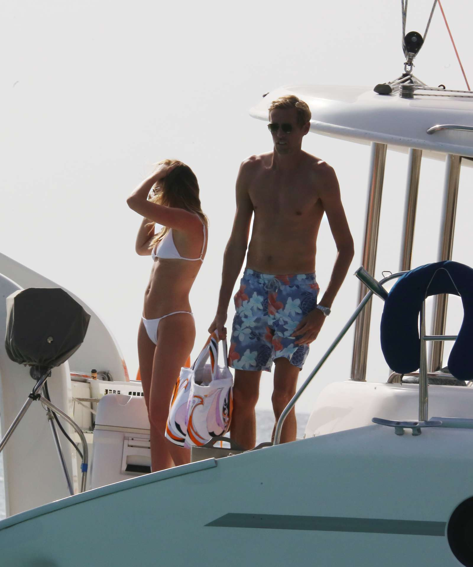 Abbey Clancy in White Bikini on a Yacht in Barbados