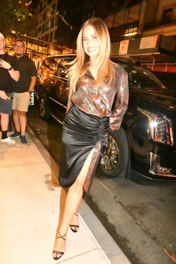 Addison Rae - Dons metallic look a she leaves her hotel in New York