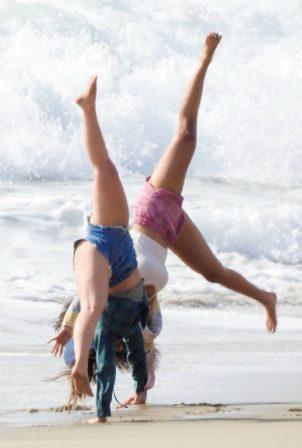 Addison Rae - Photo shoot candids at a beach in Malibu