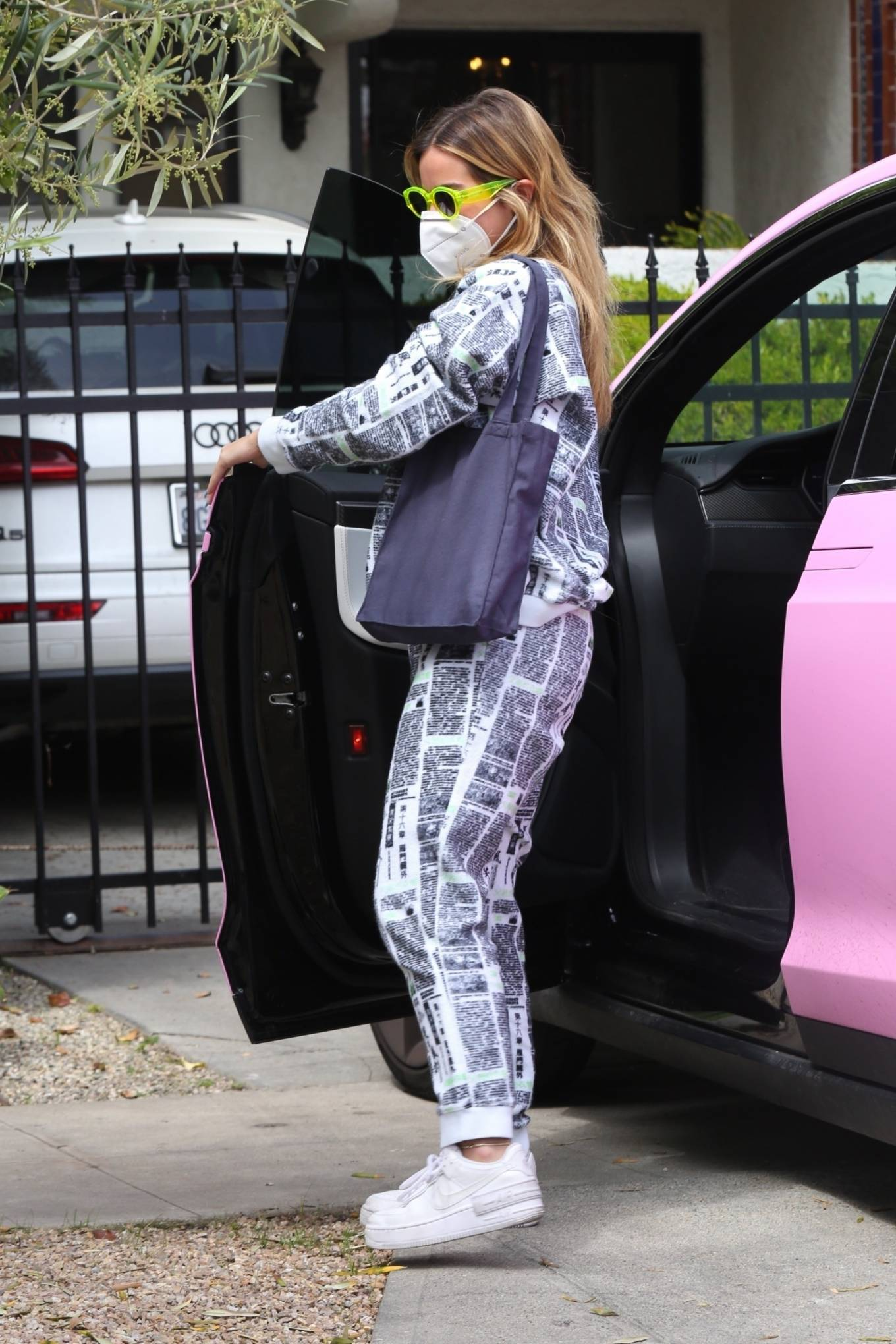 Addison Rae - Wears on-trend newspaper print sweats in Hollywood